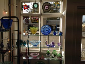 hand made glass window display by Julia Linstead